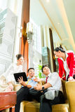 Asian Chinese business people meeting in hotel lobby Royalty Free Stock Images