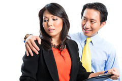 Asian Chinese business - Sexual harassment. Asian Chinese Employee or secretary getting manager or business men sexual harassed or harassment and reject him Royalty Free Stock Photography