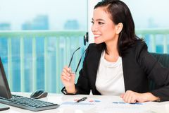 Asian Chinese businesswoman in office Stock Image