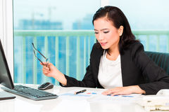 Asian Chinese businesswoman in office Stock Photography