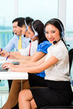 Asian Chinese call center agent team. On phone Stock Images