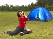 Asian Chinese camper using phone Royalty Free Stock Photography