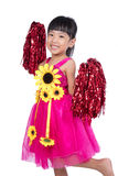 Asian Chinese cheerleader girl holding a pompom. In isolated white background Royalty Free Stock Images