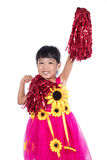 Asian Chinese cheerleader girl holding a pompom. In isolated white background Stock Photo