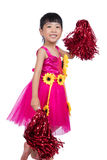 Asian Chinese cheerleader girl holding a pompom. In isolated white background Stock Image