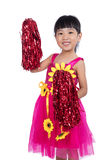 Asian Chinese cheerleader girl holding a pompom. In isolated white background Stock Photos