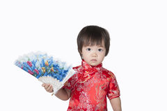 Asian chinese children. Happy Chinese new year.The boys expressed his delight with the Chinese New Year, isolated on white background Royalty Free Stock Photos