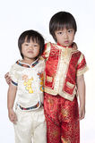 Asian chinese children. Happy Chinese new year.Children express their joy with the Chinese New Year, isolated on white background Royalty Free Stock Photo