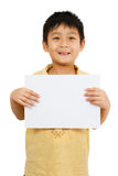 Asian Chinese Children Holding blank white board. Asian Chinese Little Boy Holding blank white board Royalty Free Stock Image