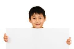Asian Chinese Children Holding blank white board. Asian Chinese Little Boy Holding blank white board Stock Photos