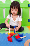 Asian Chinese children playing with blocks Royalty Free Stock Photos