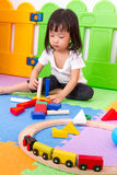 Asian Chinese children playing with blocks Royalty Free Stock Image