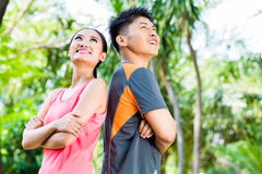 Asian Chinese couple finish running training in park Stock Photo