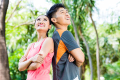 Asian Chinese couple finish running training in park Royalty Free Stock Photo