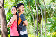 Asian Chinese couple finish running training in park Stock Image