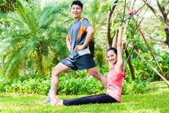 Asian Chinese couple at fitness training Stock Images