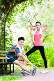 Asian Chinese couple at outdoor fitness training Royalty Free Stock Photography