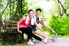 Asian Chinese couple at outdoor fitness training Stock Photos