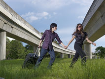 Asian Chinese couple traveling with luggage Royalty Free Stock Photo