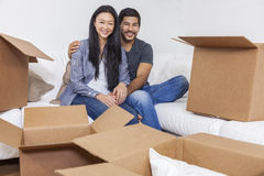 Asian Chinese Couple Unpacking Boxes Moving House Stock Images