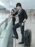 Asian Chinese Couple waiting at the airport Royalty Free Stock Images