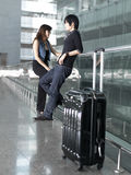 Asian Chinese Couple Waiting At The Airport Stock Photos