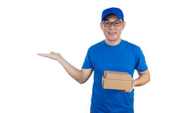 Asian Chinese delivery guy in uniform with open palm Royalty Free Stock Photography