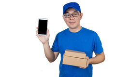 Asian Chinese delivery guy in uniform showing mobile phone Stock Photo
