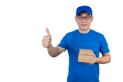 Asian Chinese delivery guy in uniform showing thumbs up Royalty Free Stock Photo