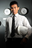 Asian Chinese engineer in office with global time Royalty Free Stock Photography
