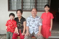Asian chinese family. Asian chinese grandparents and grandchildren with cheongsam Royalty Free Stock Image