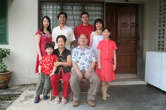Asian chinese family. 's portrait in front of the house Royalty Free Stock Photography