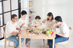 Asian Chinese family dinner. Happy Asian Chinese multi generations family dining at home stock photo