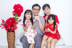Asian Chinese family with greeting gesture celebrating for Chine. Se New Year at home stock photo