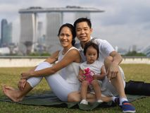 Asian Chinese Family outdoor in a park in Singapore. With little girl feeling stern Stock Photos