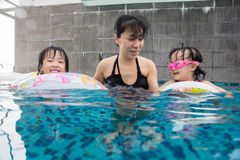 Asian Chinese family playing at the outdoor swimming pool Stock Image