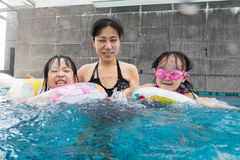 Asian Chinese family playing at the outdoor swimming pool Stock Photography