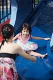 Asian Chinese family playing in swimming pool. Outdoor Stock Photography