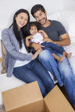 Asian Chinese Family Unpacking Boxes Moving House Royalty Free Stock Image