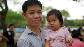 Asian chinese father carrying daughter Royalty Free Stock Photography