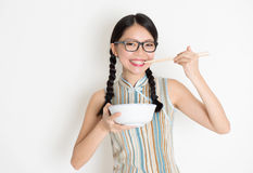 Asian Chinese female eating Stock Photography