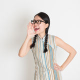 Asian Chinese female  shouting loud Royalty Free Stock Images