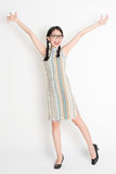 Asian Chinese girl arms outstretched Stock Photography