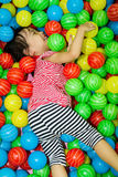 Asian Chinese Girl In Ball Pool Royalty Free Stock Photography