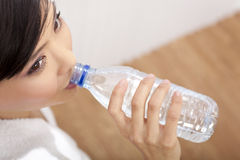 Asian Chinese Girl Drinking Bottle of Pure Water Stock Photography