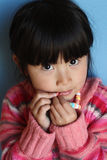 Asian Chinese Girl Eating Candy stock photo