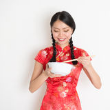 Asian chinese girl eating something Royalty Free Stock Images