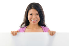 Asian Chinese girl holding placard Stock Images