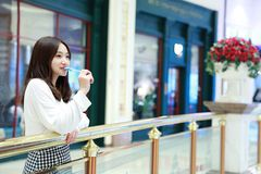 Asian chinese girl licking a lollipop Royalty Free Stock Photography