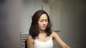 Asian chinese girl preparing to brush her teeth Stock Photos